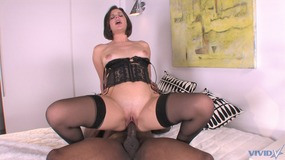 Hot brunette spreads her legs on the bed and black cock fucks her pussy