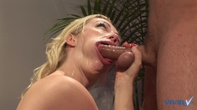 Sexy blonde slut gets on her knees and gives a hot sloppy blowjob to a big dick