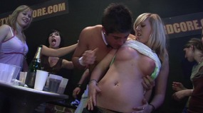 Horny brunette girl gives head at a wild orgy