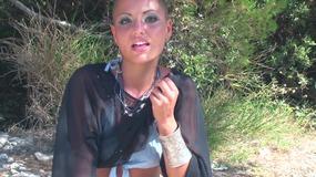 Nice tanned girl using dildo outdoor