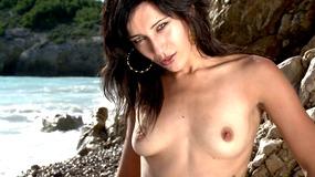 Seaside brunette shows all before skinny dipping