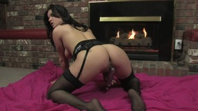 Curvy babe in sexy lingerie fucks her cunt solo in front of the fireplace