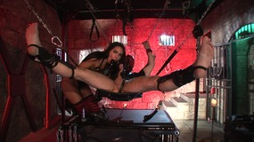 Man in a dungeon is used as sexy vixen's fuck slave