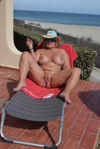 75934-Nude smoking on the beach-nudechrissy